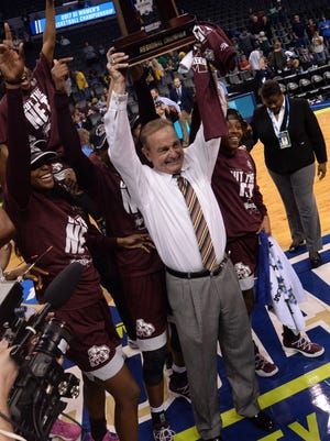 Mississippi State Lady Bulldogs head coach Vic Schaefer hoists the trophy after defeating the Baylor Bears in the finals of the Oklahoma City Regional last week.