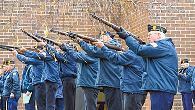 Belle Plaine's Legion fires a volley at the 2014 Veterans Day program in Belle Plaine.