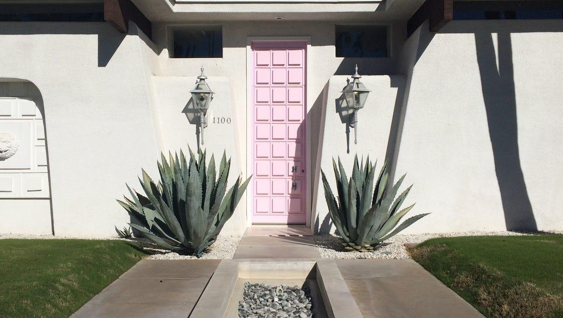 Pink door on midcentury home in Palm Springs has fans