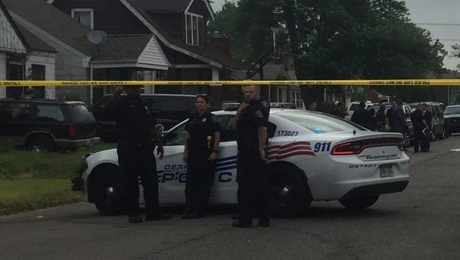 Police investigate a crime scene in Detroit on June 13, 2018.