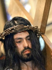 Hugo Nieto portrayed Jesus during York, Pa.'s, St. Mary's Catholic annual Easter procession several years ago. The annual Good Friday processions set the stage for the Easter message of forgiveness, reconciliation and resurrection. The idea of Amish grace, popularized by the tragedy at Nickel Mines, ties into this day.
