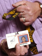 Norina Bentzel's ID card was slashed when she was attacked in 2001 by a man with a machete. She also had a thumb and two other fingers nearly severed in the attack at North Hopewell-Winterstown Elementary as well as multiple other injuries to her arms. She is now retired from Red Lion Area School District and works as an adjunct professor at York College while speaking publicly about the attack to organizations, prisons and schools.