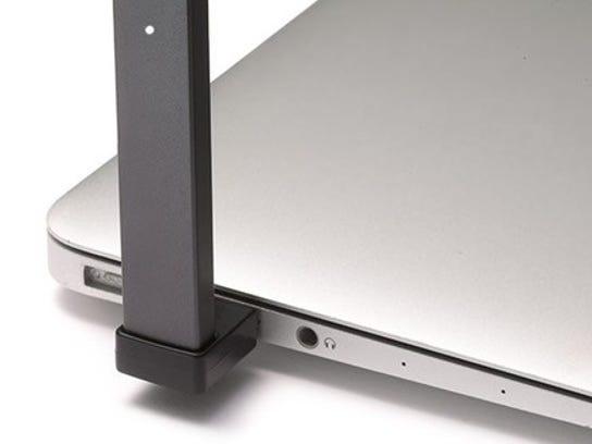 JUUL e-cig device plugged into laptop USB port