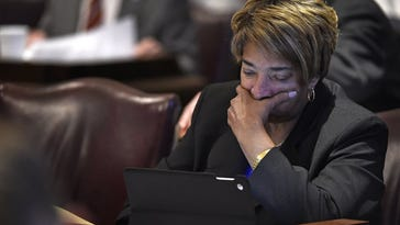 Rep. JoAnne Favors of Chattanooga studies her computer during the debate on whether to override Gov. Bill Haslam's veto of the bill seeking to make the Bible the state's official book Wednesday, April 20, 2016, in Nashville. The House voted not to override the veto.