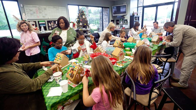 Children create gingerbread houses at Cooking with Class in La Quinta on Saturday, December 4, 2010.
