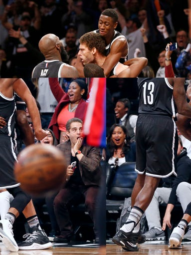 Teammates celebrate with Brooklyn Nets center Brook