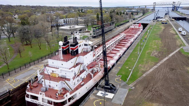 The 634-foot American Courage freighter heads towards Lake Superior through the Soo Locks on the St.Mary's River in Sault Ste. Marie. The U.S. locks are run by the U.S. Army Corps of Engineers. Congress has authorized, but not funded, a new lock.