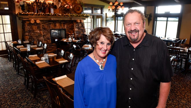 Mar and Mike Dols, owners of Coyote Moon Grille, in the dining area Saturday, Aug. 12, in St. Cloud.