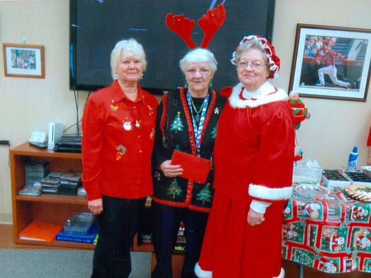 The Millville Senior Center was rocking Dec. 10 during the annual Christmas dinner financed and served by the Millville Fire Department and provided by Verna's Flight Line Restaurant. Bob Morgan and DJ Entertainment provided music for attendees. Pictured (from left): Peggy Parliman, senior center director Sylvia Stites and Mrs. Santa Claus, also known as Janice Graf.