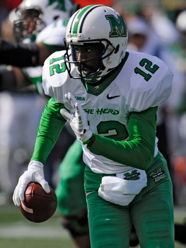 Marshall quarterback Rakeem Cato (12) said the Herd