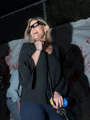 Mallory Studer reacts to frights as she makes her way