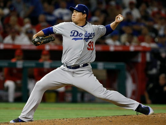 Los Angeles Dodgers starting pitcher Hyun-Jin Ryu throws to a Los Angeles Angels batter during the sixth inning of a baseball game in Anaheim, Calif., Monday, June 10, 2019. (AP Photo/Alex Gallardo)