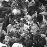 A.J. Foyt acknowledges the crowd after winning his fourth Indianapolis 500 in 1977