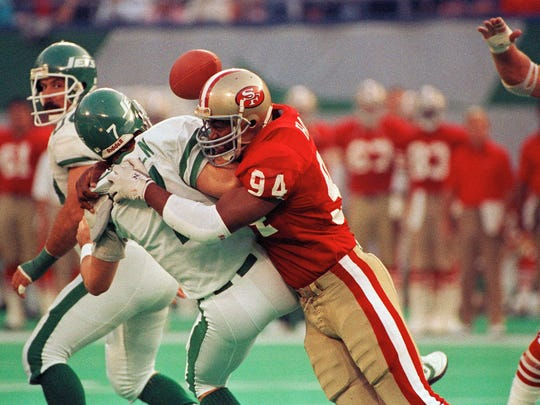 FILE - In this Oct. 29, 1989, file photo, New York Jets quarterback Ken O'Brien is sacked by San Francisco 49ers' Charles Haley in the first quarter of play in East Rutherford, N.J. Haley will be inducted into the Pro Football Hall of Fame this weekend in Canton, Ohio. (AP Photo/Bill Kostroun, File)