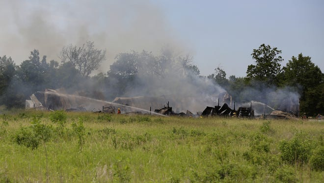 Crews from the Omro Rushford, Winneconne-Poygan, town of Algoma, Vinland and Utica fire departments respond about 9 a.m. Friday, June 16, 2017, to a pole shed fire at 7195 County Highway B, just east of the Winneconne-Poygan town line. Nobody was injured, and there were no animals in the shed.
