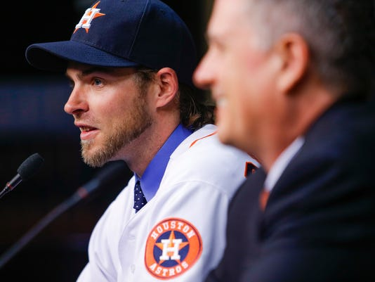 Houston Astros new outfielder Josh Reddick, left, takes questions along with with general manager Jeff Luhnow as he is introduced at Minute Maid Park in Houston, Wednesday, Nov. 23, 2016. ( Michael Ciaglo/Houston Chronicle via AP)