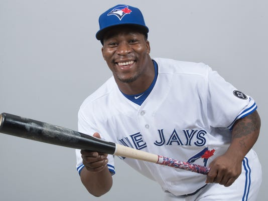 "FILE - This is a 2018 file photo showing Gift Ngoepe of the Toronto Blue Jays baseball team. Ngoepe had quite the busy offseason. After becoming the first African-born player to reach the major leagues last season, Ngoepe was traded from Pittsburgh to Toronto and spent almost three months back home in South Africa promoting the sport. ""Just trying to make the sport a little bigger, make more people interested and playing so we have a bigger population for baseball,"" Ngoepe told The Associated Press on Friday, March 8, 2018. (AP Photo/John Minchillo, File)"