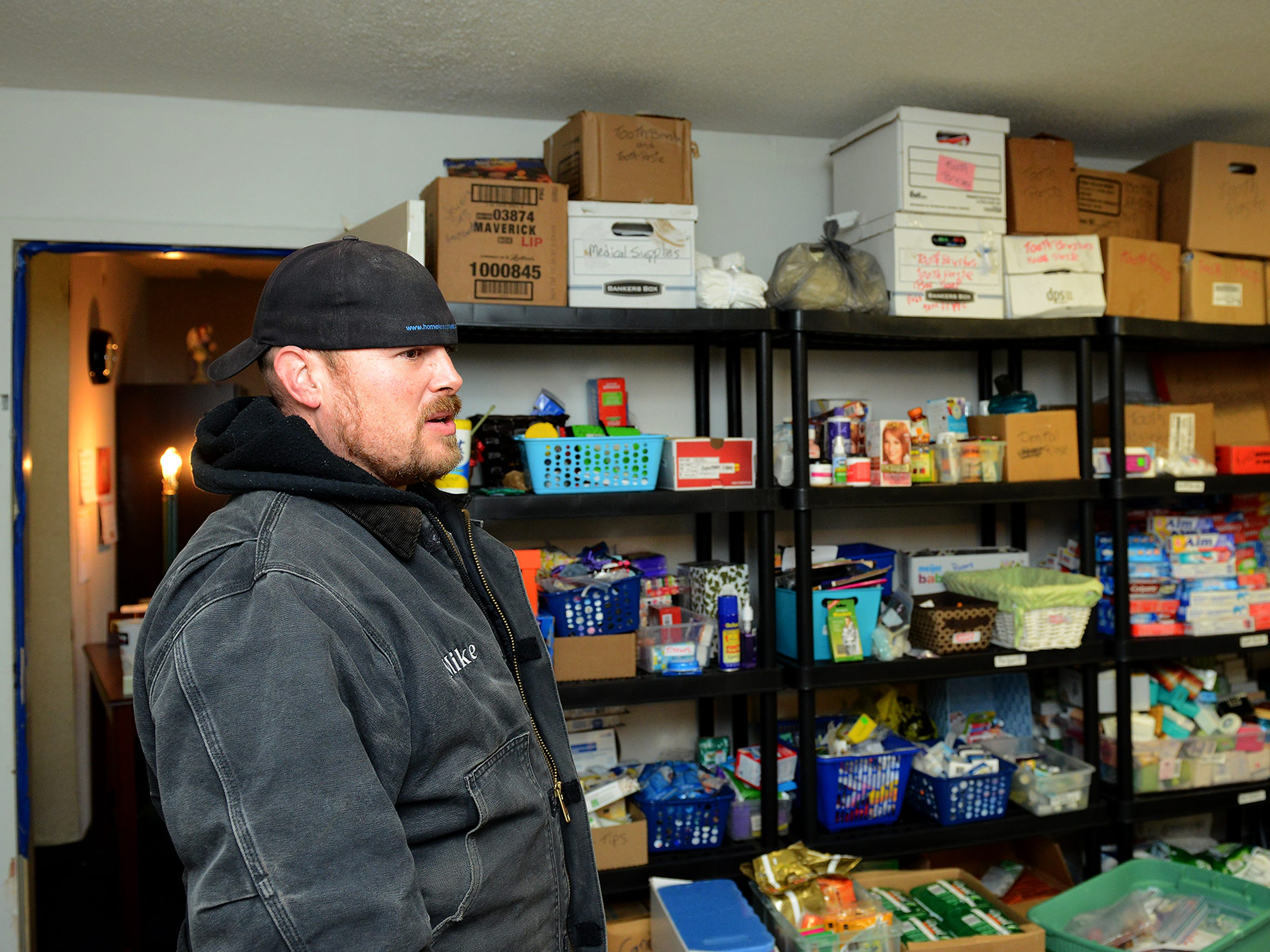 Mike Karl stands in the organization's personal needs storage room in the Magnusson Hotel  Nov., 19 in Lansing. Karl's organization, the Homeless Angels, uses the hotel to house people as they help them find permanent housing. They also provide other assistance to the area's homeless.