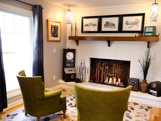 The fireplace nook at the home of Wanda and Darnell Thompson features antique pieces as well as vintage mid-century modern furnishings.