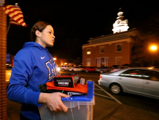 MTSU womens basketball player TiAnna Porter helps move