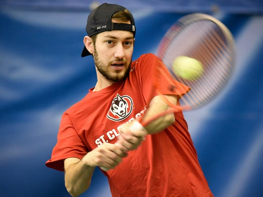St. Cloud State University's Joao Souto returns the ball during practice Tuesday, May 3, at Fitness Evolution in Sartell.