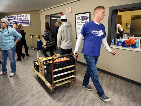Brian Leitza joins a group of volunteers Saturday,