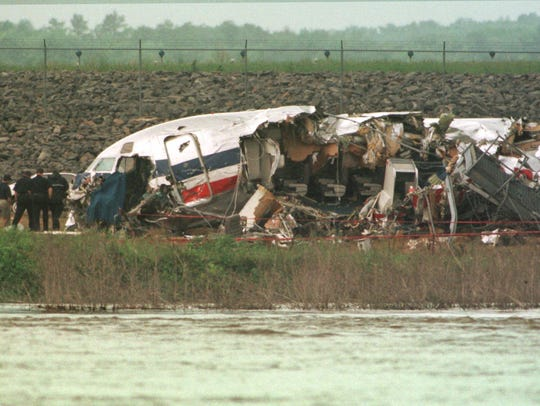 Investigators examine the wreckage of an American Airlines