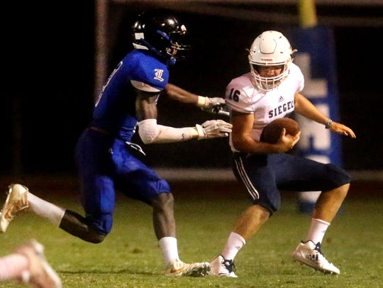 Siegel quarterback Tucker Sears tries to elude a La Vergne defender during a 2017 jamboree. Sears will take over the starting QB duties for the Stars in 2018.