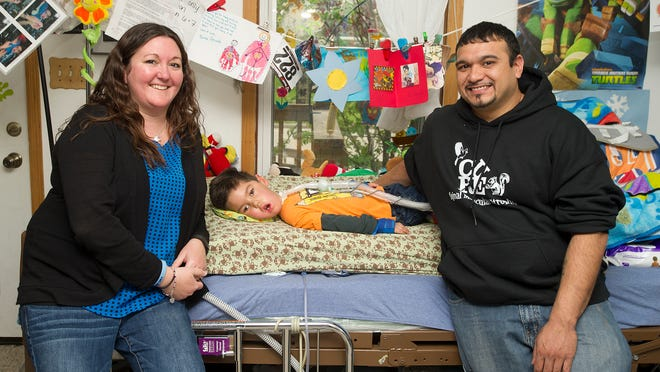 Amy and Adan Medina of Fond du Lac have struggled to take care of their son, Mateo, who has spinal muscular atrophy. Amy is expecting a second child in early 2016 who also has the chronic malady.