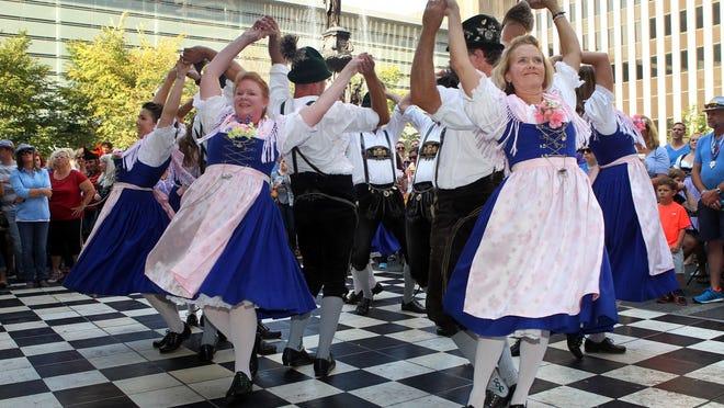 Oktoberfest-Zinzinnati hits Downtown this weekend. Pictured: Members of Cincinnati Enzian perform a traditional Schuhplattler dance at Oktoberfest Zinzinnati 2014.
