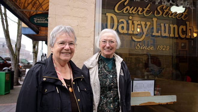 Carol Snyder, left, and Mary Cooper promote the Rotary Club during Holding Court at Court Street Dairy Lunch on Tuesday, January 6, 2015, in Salem.
