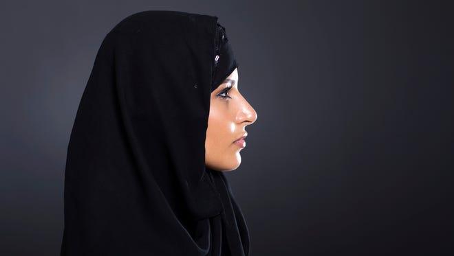 Woman in a hijab.