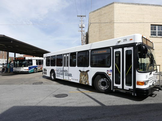 The new City Utilities bus transfer station being built on Main Avenue was designed to more easily accommodate longer vehicles, like this refurbished, two-door bus seen leaving the downtown station on Thursday.