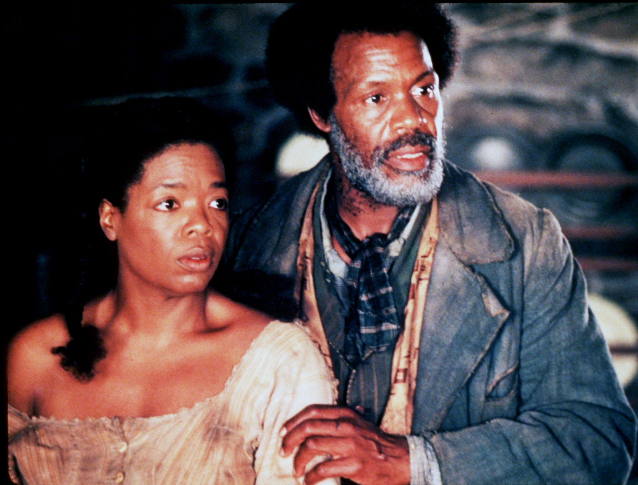 'Beloved' | Based on the 1987 Pulitzer Prize-winning novel of the same name by Toni Morrison, 'Beloved' was a passion project for Winfrey. She purchased the rights to the book soon after it was published, produced the film and starred in it. The 1998 film was directed by Jonathan Demme ('The Silence of the Lambs'), and followed the story of Sethe (Winfrey), a former slave rattled by the spirit of her dead daughter. Here, Sethe (Winfrey) stands close to her friend Paul (played by Danny Glover).