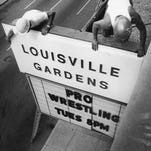 Workers erected a new sign atop the marquee of the Armory, now called Louisville Gardens.  July 25, 1975