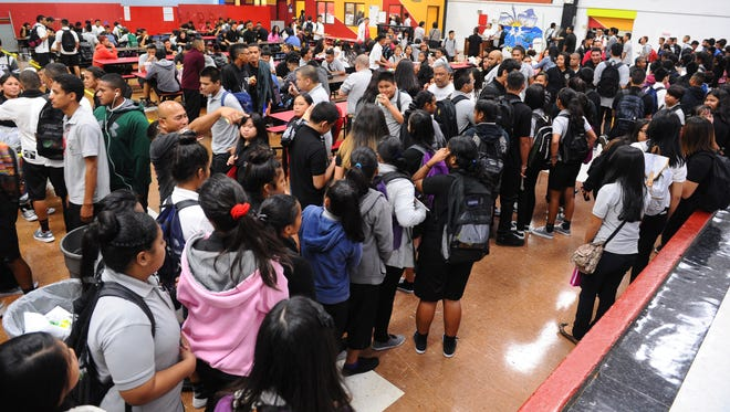 Students gather for lunch in the cafeteria during the first day of classes at Simon Sanchez High School in Yigo on Monday, Aug. 17. Rick Cruz/Pacific Daily News/rmcruz@guampdn.com