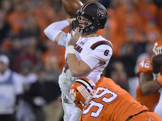 South Carolina quarterback Jake Bentley throws a pass while defended by Clemson's Clelin Ferrell during the first half of an NCAA college football game Saturday, Nov. 26, 2016, in Clemson, S.C. (AP Photo/Richard Shiro)