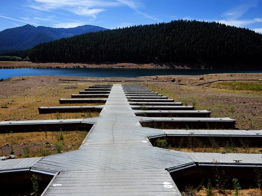 Boat Dock F at the Detroit Lake State Park campground rests on dry land, on Tuesday, June 23, 2015, in Detroit, Ore.