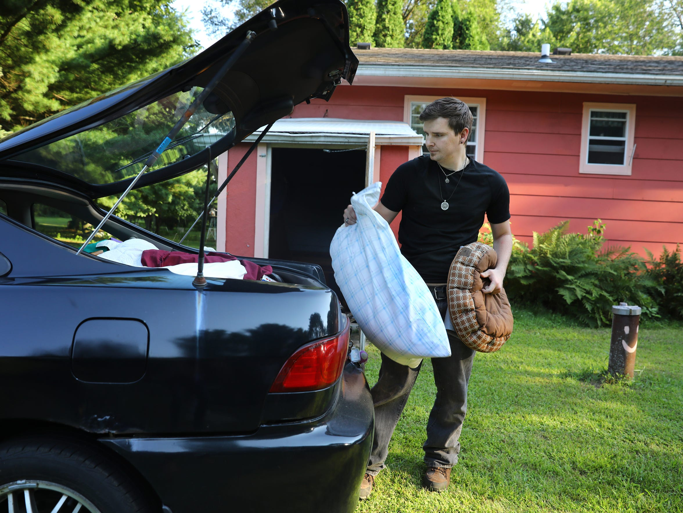 Cody McCormick, 29, packs belongings into his fiancé