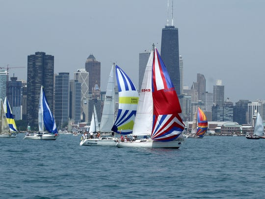 This July 21, 2012, file photo shows racing sailboats of Fantome, right front, USA 6949, owned by Deirdre Martin, of Chicago, with Chicago Yacht Club, at the start of the annual Chicago Yacht Club Race to Mackinac on Lake Michigan, passing Navy Pier in Chicago. The race of roughly 290 nautical miles begins on Lake Michigan just off Chicago's Navy Pier and ends on the other side of the Mackinac Bridge near small, picturesque Mackinac Island on Lake Huron.