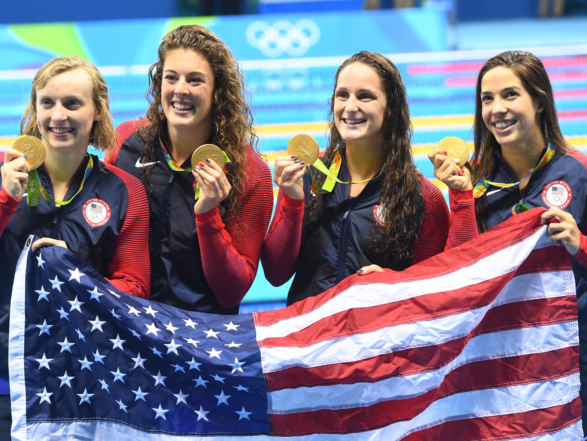 Allison Schmitt, second from left, celebrates her gold