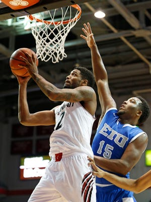 Octavius Ellis, left, reluctantly gave up being a perimeter player, but has since become UC's leading scorer.