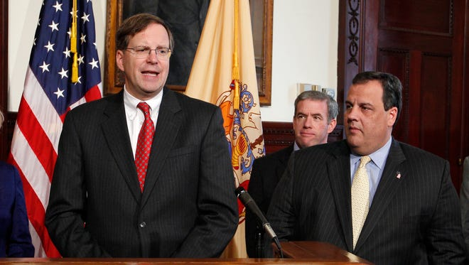 New Jersey Gov. Chris Christie, right, and Jeff Chiesa, listen to Christie's Chief of Staff Richard Bagger at the State House in Trenton. Despite being passed over for the job of Trump's running mate, Christie and an entourage of his closest allies could leave a lasting mark on a Trump administration, should he win in November. As chairman of Trump's transition team, Christie is building a coalition of advisers who will staff key federal government agencies and execute new policy prescriptions if Trump wins the general election. Among them, are two of his longtime aides, Bagger, a lobbyist who helped lead Christie's gubernatorial transition team and Bill Palatucci, a top Christie adviser whose law firm has been showered with government legal work.