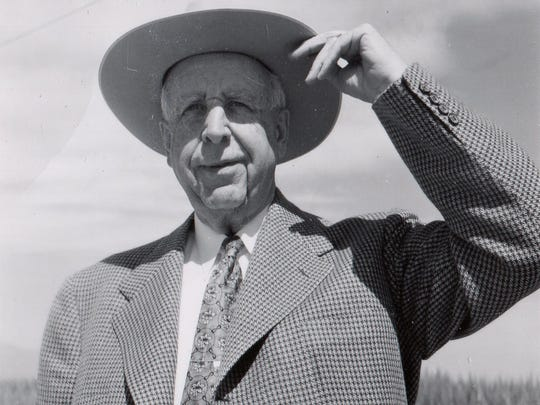 Paul Litchfield, circa 1930, looks over one of his