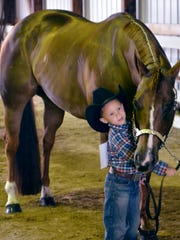 Five-year-old Jaelyn Taylor positions his horse in a jackpot halter class competition at the Manitowoc County Expo on Sunday. Taylor won two halter class competitions earlier in the day, which qualified him for the jackpot round. He did not place in the jackpot round, in which he competed against adults.