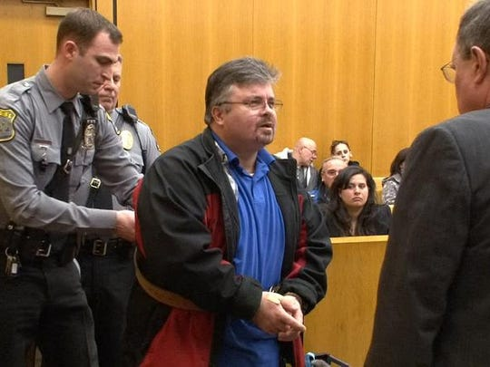 Thomas Scalgione, Stafford, is taken into custody in Superior Court in Toms River Friday. He was sentenced to six months in the county jail for operating a 9/11 scam charity using a pickup truck painted with the Twin Towers and the names of police and firefighters who died at Ground Zero.