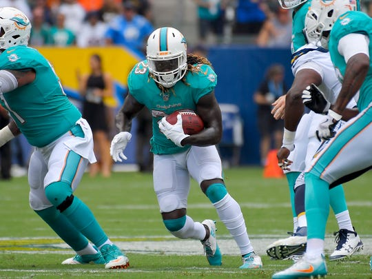 Miami Dolphins running back Jay Ajayi runs with the ball during the first half of an NFL football game against the Los Angeles Chargers, Sunday, Sept. 17, 2017, in Carson, Calif. (AP Photo/Mark J. Terrill)