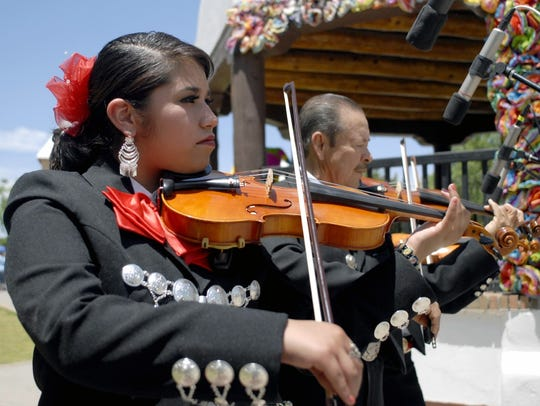 Maria Carrillo of Mariachi Alma de Jalisco plays a