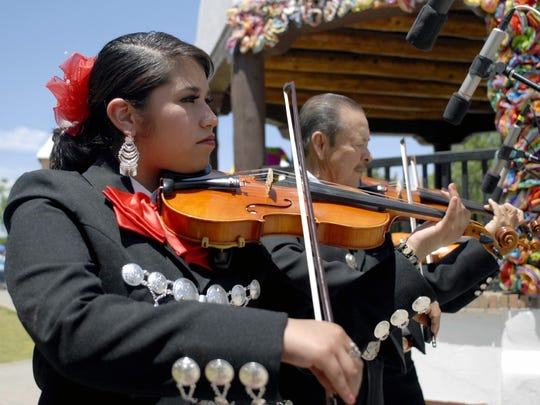 Maria Carrillo of Mariachi Alma de Jalisco plays a traditional song at a recent Cinco de Mayo celebration on the Mesilla Plaza. This year's fiesta will feature live entertainment, arts and crafts and food vendors, rides and games Saturday and Sunday on the plaza.