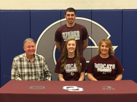 Galena High School standout Megan Caulfield signed a letter of intent to play for the College of the Ozarks Lady Bobcats volleyball team on Tuesday, Feb. 27. 2018 at Galena High in Galena, Missouri. Caulfield was surrounded by friends and family for the formal commitment ceremony, including her father, Steve (left), mother Donna (right) and brother Cameron (back), who already attends C of O.